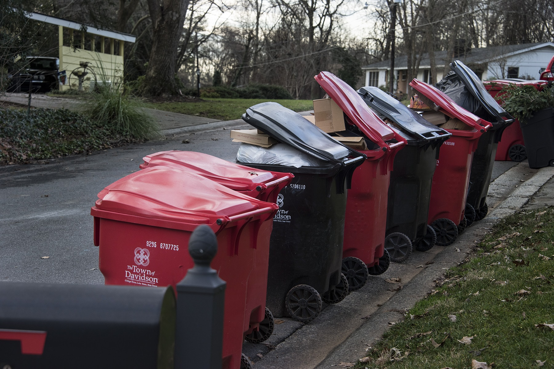 Christmas Past — An overflowing bounty! The holidays left behind overflowing rubbish bins full of cardboard boxes and wrapping paper and all around town for sanitation workers to cart away.